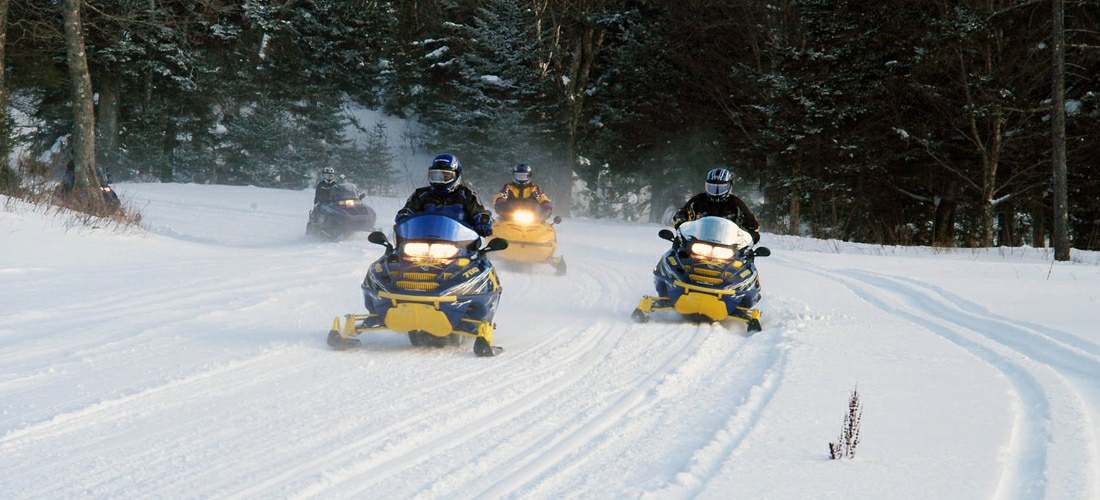 Hundreds of miles of trails keep snow machines entertained throughout the winter months in New Hampshire.