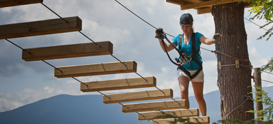 A challenging ropes course at mount cranmore is one of many outdoor adventure available for visitors to this beautiful state-  New Hampshire USA Travel Guide.