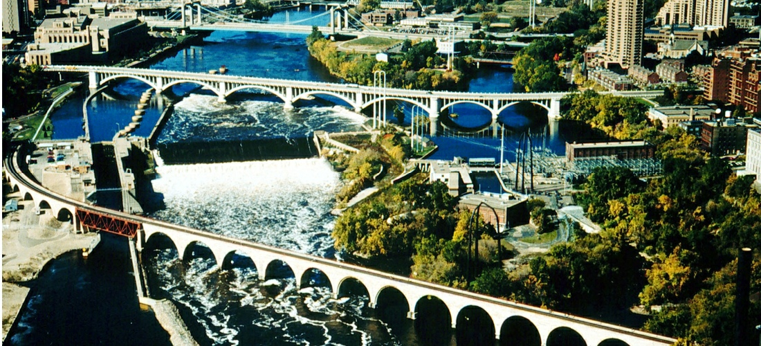 The Stone Arch Bridge is a former railroad bridge crossing the Mississippi River at Saint Anthony Falls in downtown Minneapolis, Minnesota. 117 Portland Avenue is the general address of the historic complex.