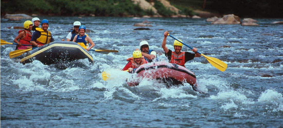 Whitewater rafting Nolichucky River in Tennessee. TN  family float trips, riverside camping, mountain biking tours and overnight accomodations - See America!